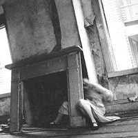 "Francesca Woodman, ""P.21 / House # 4, Providence, Rhode Island"" (1975-1978). Estate gelatin silver print, printed 1997-2003. 10"" x 8"". Courtesy the Estate of Francesca Woodman and Marian Goodman Gallery , New York."