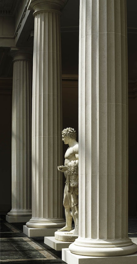View of the Leon Levy and Shelby White Court, with marble statue of the youthful Hercules. Roman, Flavian period, A.D. 69-98. Adaptation of a Greek statue type of the 4th century B.C. The Metropolitan Museum of Art, Gift of Mrs. Frederick F. Thompson, 1903 (03.12.13) © The Metropolitan Museum of Art, New York