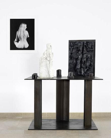 "Ariane Lopez Huici ""Priscille,"" 2009. Silver gelatin print.  Alain Kirili, ""Generation,"" 1992. Marble, iron, and bronze, 168 × 140 × 94 cm. Courtesy Musée des Beaux-Arts de Caen, France."