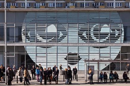 "Museum of Modern Art in Warsaw, with the work by Paulina Ołowska ""emilia's Face,"" on the front wall, 2014. Courtesy Museum of Modern art in Warsaw. photo by Bartosz Stawiarski."