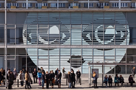 "Museum of Modern Art in Warsaw, with the work by Paulina Ołowska ""emilia's Face,"" on the front wall, 2014. Courtesy Museum of Modern art in Warsaw. photo by Bartosz Stawiarski."