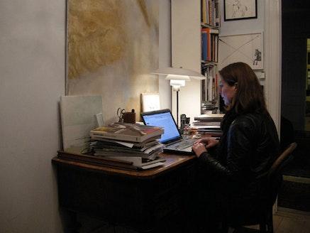 The art critic Lisbeth Bonde working in her studio in copenhagen.