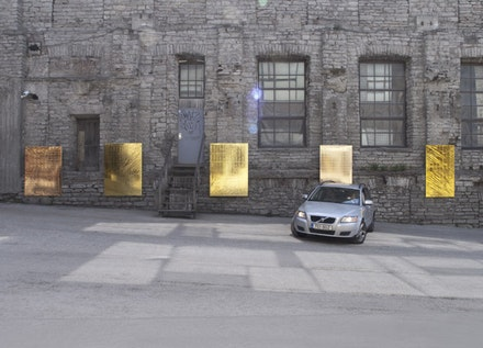 "Mikkel Carl, ""Brand New Paintings Caught in the Headlights of Parking Cars,"" 2013. Mylar emergency blankets (gold), stretchers, cars. Dimensions variable."