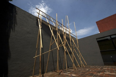 "Katya Gardea Browne, ""Sweet Sugar,"" 2009. Scaffold wood, galvanized screws and fireworks, 10 m high. Museo el Eco, Mexico City."