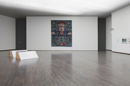 """Lotte Konow Lund, """"66 minutes."""" Wood, drawings, video, and miniatures made for the exhibition, 155 × 60 × 120 cm. Sixty-six minutes is the time it took Anders Behring Breivik to kill the youth at the Labor party's summer camp at Utoya in his terrorist actions in 2011. The piece that seems to be a minimalist object is made as a hiding place for a child. Lotte Konow Lund collaborated with her daughter while making the piece, discussing what her daughter would need to feel safe and be quiet for 66 minutes. The small room is filled with miniature versions of objects from her daughter's room, and copies of drawings her daughter made the same years. The second box is a replica of the first one."""