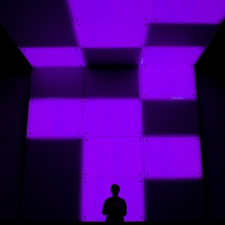 TECHknowSELF. It is a site-specific performance installation utilizing projections and a massive LED wall, which exists as part of a café.