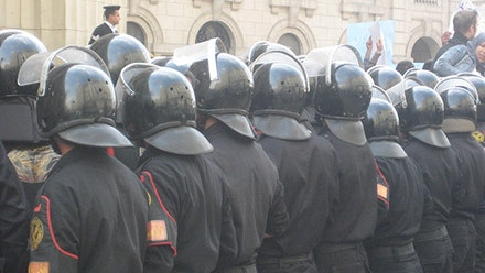 Yasmine El Rashidi, Egyptian riot police outside the main court in downtown Cairo, January 25, 2011, from <em>Words Not Spent Today Buy Smaller Images Tomorrow: Essays on the Present and Future of Photography</em> (Aperture, 2014). Courtesy Yasmine El Rashidi.