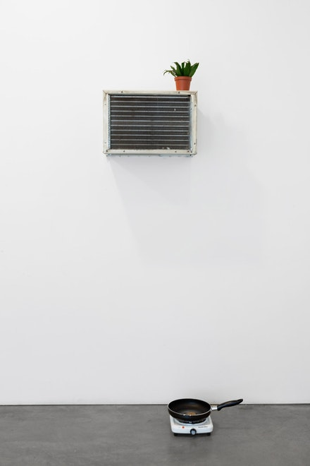 "Mika Rottenberg, ""Tsss Tsss Tsss,"" 2014. Air conditioner, plant, hotplate, frying pan, water. Dimensions variable. Courtesy of Andrea Rosen Gallery."