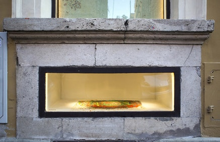 """Maria Morganti, """"Impronta 2010 – 12"""". Installation view, pastels and oil sticks. Photo: D. Aichino. Notice the bits of color embedded in the window sill (Scheggia). A partial view of Nel travertino is seen in the window above."""