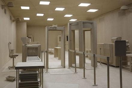 "Roxy Paine, ""Checkpoint,"" 2014. Maple, aluminum, fluorescent light bulbs, acrylic prismatic light diffusers, 14 ́ × 26 ́ 11 ̋ × 18 ́ 7 1/2 ̋. Courtesy of the artist and Marianne Boesky Gallery, New York."