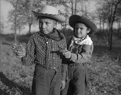 """Robert """"Corky"""" and Linda Poolaw (Kiowa/Delaware), dressed up and posed for the photo by their father, Horace. Anadarko, Oklahoma, ca. 1947. © 2014 Estate of Horace Poolaw. Reprinted with permission."""