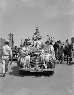 Left to right: Juanita Daugomah Ahtone (Kiowa), Evalou Ware Russell (center), Kiowa Tribal Princess, and Augustine Campbell Barsh (Kiowa) in the American Indian Exposition parade. Anadarko, Oklahoma, 1941. © 2014 Estate of Horace Poolaw. Reprinted with permission.