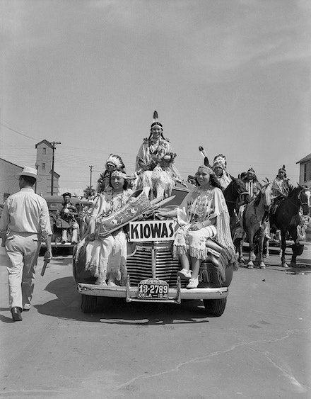 Left to right: Juanita Daugomah Ahtone (Kiowa), Evalou Ware Russell (center), Kiowa Tribal Princess, and Augustine Campbell Barsh (Kiowa) in the American Indian Exposition parade. Anadarko, Oklahoma, 1941. © 2014 Estate of Horace Poolaw. Reprinted with permission.