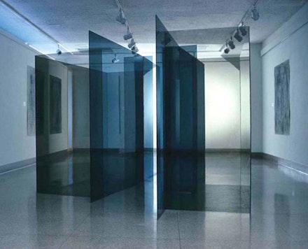 "Raquel Rabinovich, ""Invisible Cities,"" 1986. Grey and bronze tempered glass and silicone adhesive, 74 × 144 × 102 ̋."