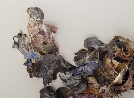"""Hedwig Brouckaert, Detail: """"a knot, a tangle, a blemish in the eternal smoothness,"""" 2014. Magazine clippings, pins, wire, hair; dimensions variable. Photo credit: Etienne Frossard."""