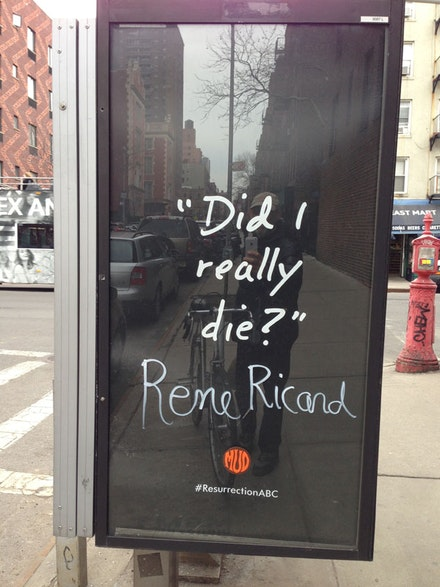 Altered advertising sign, Lower East Side, NYC, 2014. This graffiti began appearing a few days after RR's death.