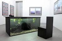 "Eric Heist, installation view ""Travel Agents"" (2005), mixed media. Courtesy of  Schroeder Romero."