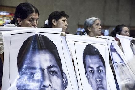 """Memoria Verdad y Justicia para Ayotzinapa"" by Isabel Sanginés (flic.kr/p/pqUDPD), used under CC BY 2.0 / Desaturated from original."