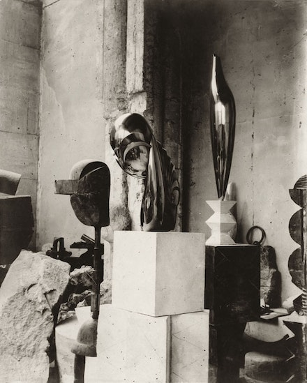 "Constantin Brancusi. View of the studio: ""Plato, Mademoiselle Pogany II"" and ""Golden Bird"" (c. 1920). Gelatin silver print, 11 3/4 × 9 1/2 ̋. Private collection. © 2014 Artists Rights Society (ARS), New York/ADAGP, Paris. Courtesy Gagosian Gallery."