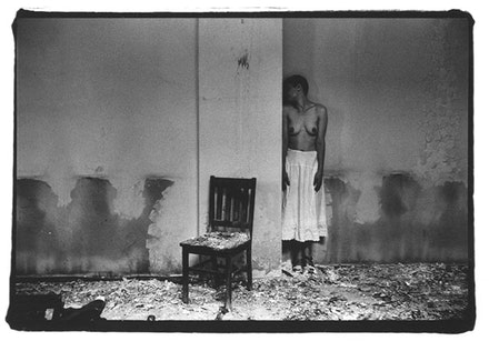 """Francesca Woodman, """"Untitled, New York (NF.416)"""" (1979 – 1980). Vintage gelatin silver print, image: 21 3/16 × 4 1/8 ̋, paper: 8 × 9 7/8 ̋. Courtesy of George and Betty Woodman and Marian Goodman Gallery."""