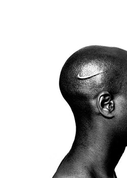 """Hank Willis Thomas, """"Branded Head"""" (2003). Lambda photograph, dimensions variable. Courtesy of the artist and Jack Shainman Gallery, New York."""