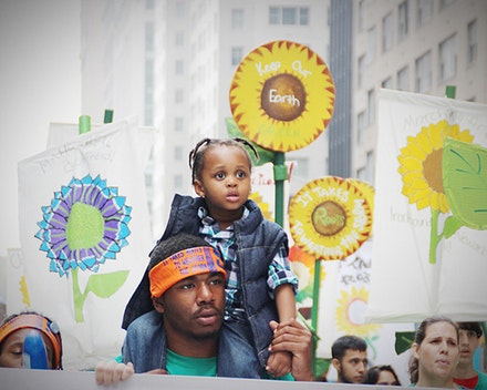 Father and Child at the historic People's Climate March; September 21, 2014. Photo: Rae Breaux.