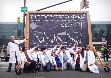 Scientist point at chalkboard made for the People's Climate March on September 21, 2014. Photo: Gan Golan.