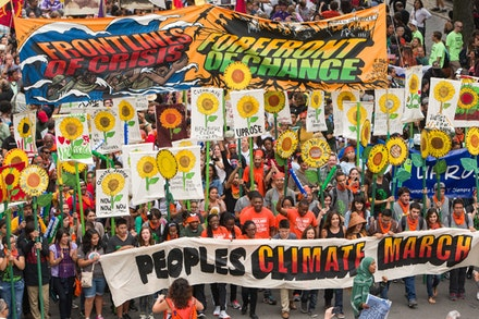 Banners created by Crystal Clarity, with sunflowers, carried by young activists from UPROSE leading People's Climate March, September 21, 2014. Photo: Robert Van Waarden.
