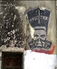 El Zeft, Nefertiti in a Gas Mask, 2012. Spray paint on concrete. Cairo, Egypt.