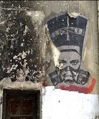 El Zeft, Nefertiti in a Gas Mask, 2012. Spray paint on concrete. Cairo, Egypt.