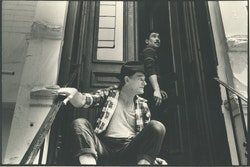 Jeff Weiss and Richard C. Martinez, aka Murphy, in the 1990s in front of their 10th street apartment, where the first shows of <em>And That's How The Rent Gets Paid</em> were performed.