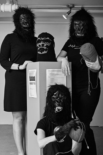(Clockwise from left) Gene Stratton-Porter, Alla Horska, and Minette de Silva at the Guerrilla Girls BroadBand Campus Rape Knit-In at FUG. (On pedestal) Knit Guerrilla Mask with copy-left knitting pattern, homage to Pussy Riot, collaboration between Guerrilla Girls Broadband and Cat Mazza. Photo by Zack Garlitos.