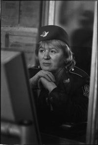 "Olga Chernysheva, <i>On Duty</i> [series] (2007). Optical silver gelatin fiber print. 53 ½""  x 35 ½""."