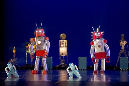 Dancers in robot suits share the stage with Nao robots and a mechanical orchestra in Blanca Li's <em>ROBOT</em>. Photo: Laurent Philippe.