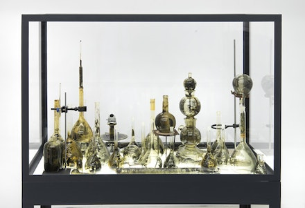 Yoan Capote, <em>Laboratorio</em>, 2012. Mixed media including gelatin silver prints on glass vessels, scientific equipment in vitrine, dimensions variable. © Yoan Capote. Courtesy the artist and Jack Shainman.