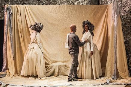 Walter Dundervill drapes fabrics on Omagbitse Omagbemi and Jessie Gold at Dundervill&#146;s <em>Arena</em>. Photo: Maria Baranova.