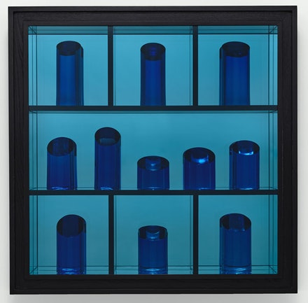 Josiah McElheny, <em>Blue Prism Painting V</em>, 2015. Hand-formed and polished blue glass, low-iron mirror, cut and polished blue architectural sheet glass, Sumi ink wood finish, oak and plywood, 43 1/2 x 43 1/2 x 7 3/8 in. Photo: Ron Amstutz.