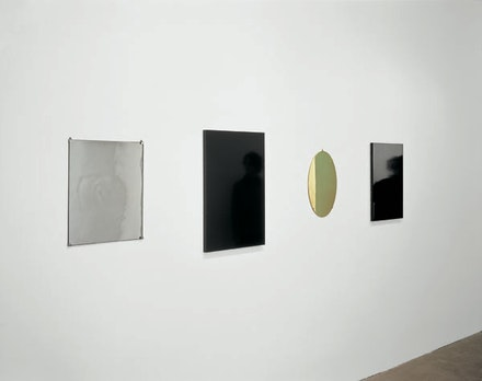 Josiah McElheny, <em>Four Mirrors after a Poem by Jorge Luis Borges</em>, 2000. Handblown and mirrored glass, French-polished ebony, polished brass, French-polished mahogany, and metal hardware; mirrored glass: 20 x 16 1/4 in.; ebony: 27 1/2 x 18 1/2 in.; brass: 18 1/4 x 12 inches; mahogany: 23 1/2 x 16 inches; running length as installed: 111 1/2 in. Photo: Tom Van Eynde.