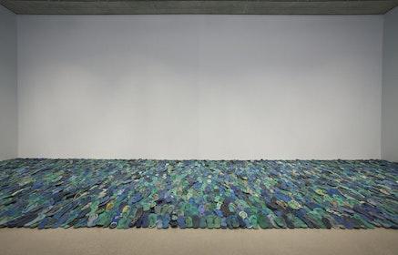 Tony Capella&#769;n, <em>Mar Caribe</em>, 1996. Plastic and rubber sandals with barbed wire. Collection Museo de Arte Moderno de la Repu&#769;blica Dominicana. Installation view: Pe&#769;rez Art Museum Miami. Photo: Oriol Tarridas.