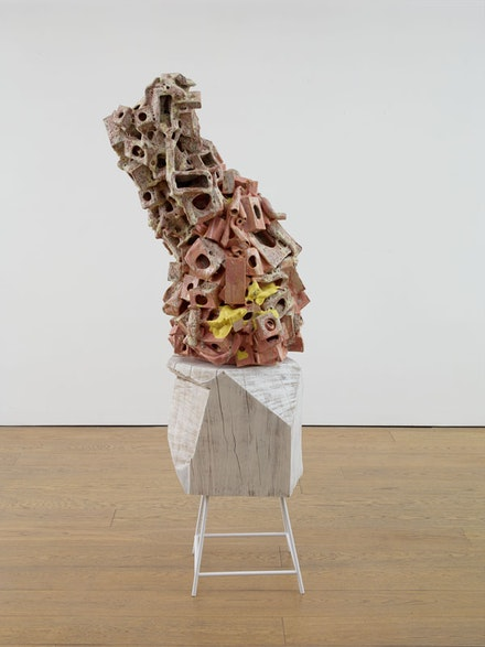 Arlene Shechet, <em>Now Playing</em>, 2015. Glazed ceramic, hardwood, paint, metal, 36 x 28 x 20 inches. (ceramic), 29 × 16 × 18.625 inches (base), 65 × 28 × 20 inches (overall). Courtesy the artist and Sikkema Jenkins & Co., New York.
