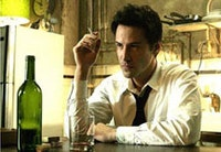 Keanu Reeves in Warner Bros.' <i>Constantine</i> (2005). Photo ©Warner Bros.