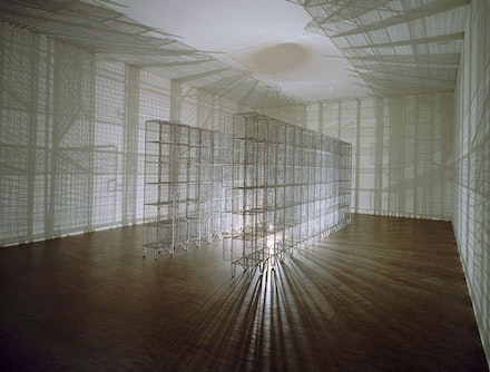 Mona Hatoum, <em>Light Sentence</em>, 1992. 36 wire mesh compartments, electric motor, light bulb, 1.98 × 1.85 × 4.90 m. ©Centre Pompidou, Musée national d'art moderne, Paris. Photo: Centre Pompidou, Mnam-CCI / Dist RMN-GP.