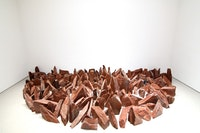 Richard Long, <em>Half Moon</em>, 2015. Red slate, 21 1/2 x 196 7/8 x 98 1/2 inches. Courtesy Sperone Westwater, New York.