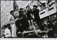 Kazuo Kitai, <em>Students with a Megaphone</em>, Nihon University College of Art Barricade, 1968. Gelatin silver print, 16 × 20 in. Courtesy the Tokyo Metropolitan Museum of Photography.
