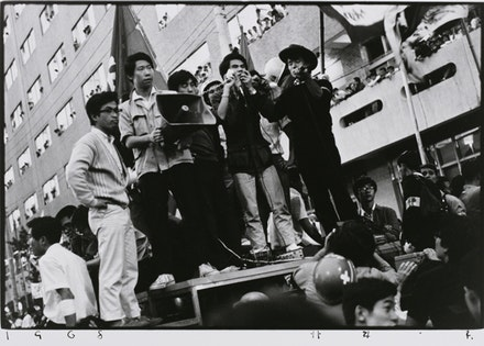 Kazuo Kitai, <em>Students with a Megaphone</em>, Nihon University College of Art Barricade, 1968. Gelatin silver print, 16 &times; 20 in. Courtesy the Tokyo Metropolitan Museum of Photography.