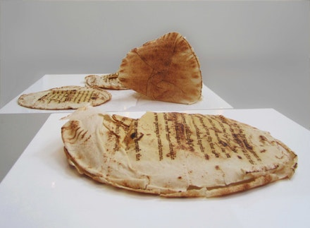 Christine Kettaneh, <em>A Beirute, with a mayo blessing</em>, 2014. Laser- engraving on bread. © Christine Kettaneh. Courtesy the artist and Ab/Anbar.