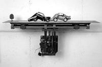 "Jonathan Schipper, ""Model for Slow Motion Car Crash"" (2005), steel, worm gears, gear motor, model cars. Courtesy of Pierogi."