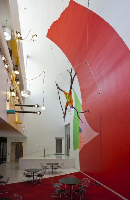 Jessica Stockholder, <i>Rose's Inclination</i>, 2015. Paint, carpet, fragment of Judy Ledgerwood's painting, branches, rope, Plexiglas, light fixtures, hardware, extension cord, mulch, Smart Museum foyer, courtyard, and sidewalks. Courtesy of the artist, Mitchell-Innes & Nash Gallery, and Kavi Gupta Gallery.