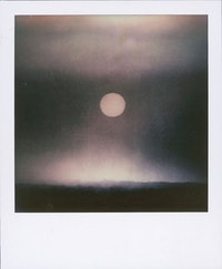 Kevin Zucker, <em>Untitled (Black & White Sunset)</em>, 2014. Polaroid. 3 1/2 × 4 1/4 inches. Courtesy the artist, Eleven Rivington, New York and Linn Luehn, Dusseldorf.