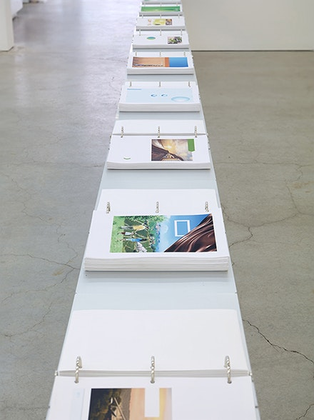 Marc Handelman, The Triple Bottom Line, 2011 – 2015. 2700 Archival Inkjet prints, 18 aluminum binders, steel table. 462 2/5 x 32 1/2 x 11 3/4 inches. Courtesy the Artist and Sikkema Jenkins & Co., New York.